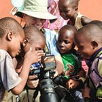 PHOTOGRAPHER CAMILLA SJODIN WITH CHILDREN IN KENYA